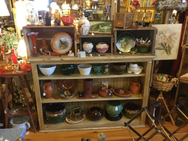 Pottery and glass on shelf
